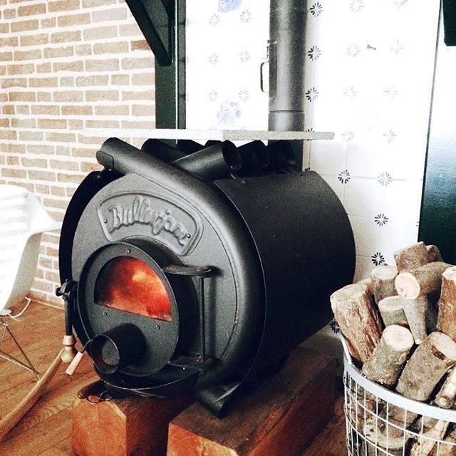 Отопление теплицы дровами - классика жанра