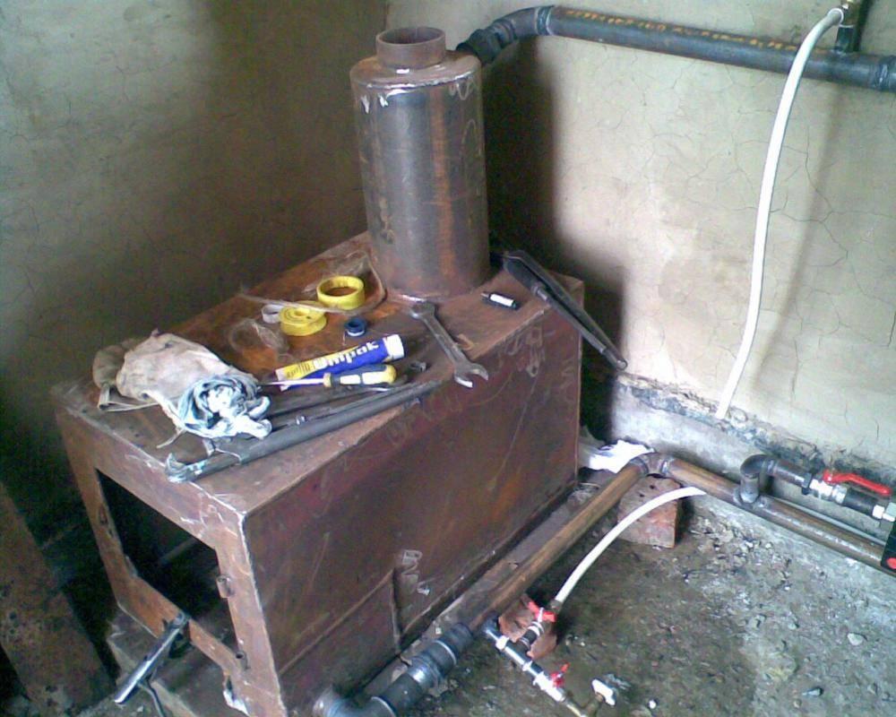 Отопление дома самодельными котлами на дровах и газе