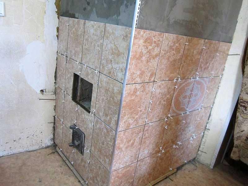 Облицовка печи керамической плиткой: технология, требования, фото
