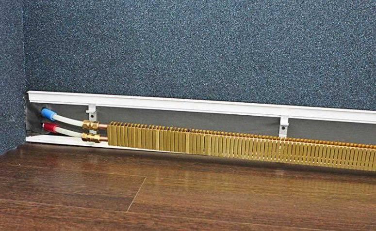 Плинтусная система отопления: теплый плинтус для труб отопления, плинтусное отопление своими руками, батарея плинтусного типа на фото и видео